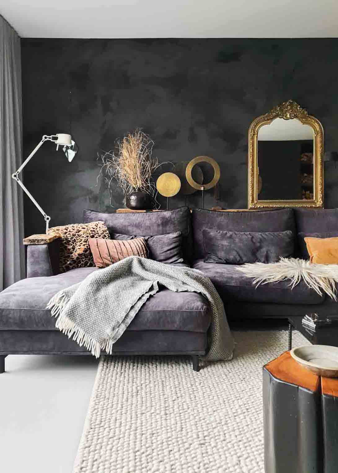 Living room with white floors, dark grey velvet couch and black wall in Marrakech Walls Slate Grey