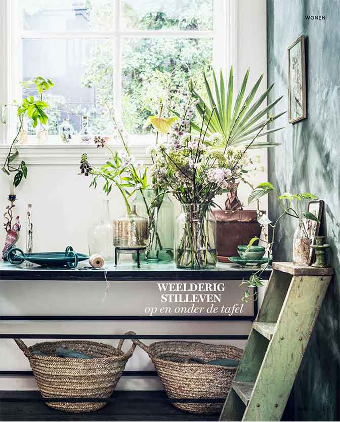 Create a botanical atmosphere by using plants, green tins and natural materials