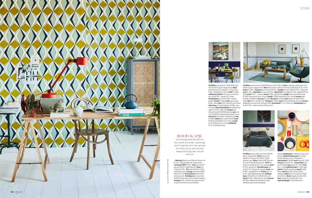 Working place with geometric wallpaper, wooden furniture and red lightning. Interior credits, wallpa